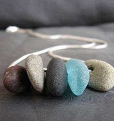 Beach Walk necklace- A beach pebble necklace made with four little stones gathered from Nova Scotia beaches, along with a single piece of genuine frosty teal sea glass on a thick and silky sterling silver snake chain inches in length). Sea Glass Necklace, Sea Glass Jewelry, Stone Jewelry, Sea Glass Art, Beach Stones, Pebble Art, Artisan Jewelry, Jewelry Accessories, Jewelry Making