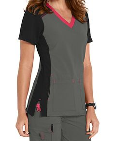 NO SWEAT, NO ODOR Everything you could want in a scrub is embodied in this color block scrub top from Carhartt. It starts with the CROSS-FLEX fabric, which was innovated to provide gentle stretch, moisture-wicking, odor blocking and stain resistance all in one great-looking garment. Four smart front and patch pockets help you keep your accessories at the ready. With contrasting knit sleeves, back yoke, side panels—as well as pop color neckline, bartacks and seaming—it's as attractive as it… Cute Scrubs Uniform, Scrubs Outfit, Greys Anatomy Scrubs, Iranian Women Fashion, Medical Scrubs, Nursing Clothes, Scrub Tops, Carhartt, Costume
