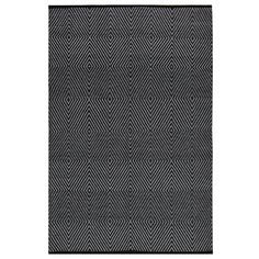 Tie any room together with the addition of this contemporary area rug. Featuring a black and white color scheme with a bold geometric pattern, this hand-woven rug offers a beautiful flat-weave construction.