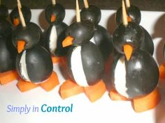 Winter Theme Party  - Penguins made out of small and large olives, cream cheese and sliced carrots. Simple and the talk of the party!