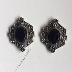 Vintage Black Stone Post Earrings •Excellent •Vintage looking post earrings. (From grandmother so idk the real date) 20-30s style?. Great condition! Marcasite exterior, I believe the black stone is onyx. All jewelry will be cleaned and sanitized before shipping. ~classy, romantic, delicate, vintage style, gothic, goth~  ❗️Please ask any & all questions before buying! 🚫No holds 🚫No trades Avon Jewelry Earrings