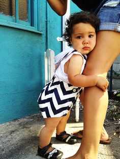 A vintage inspired romper from Right Bank Babies goes modern with bold chevron stripes.   www.rightbankbabies.com