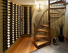 Wine cellar and spiral staircase, part of a whole home remodel by B&E General Contractors in Glendale, WI