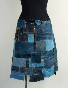 Industrial patchwork denim skirt/Patchwork denim skirt in multiple shades of blue denim. Raw edges which will fray and fade with wear and wash. One pocket with contrast stitching on the right-hand side and studs.--by PopLoveHers