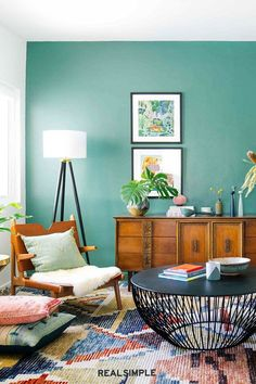 30 Easy and Chic Living Room Decorating Ideas for Any Sized Space | Want a low-budget, high-impact living room decor idea? Add an accent wall, like Dabito did here in this colorful living room. #realsimple #livingroomdecor #livingroomideas #details #homedecorinspo Chic Living Room, Living Room Decor, Colourful Living Room, Real Simple, 30th, Decorating Ideas, Budget, Ceiling Lights, Colorful