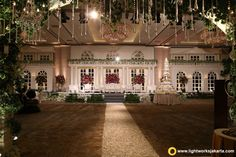 Welcoming your friends and family with warm and beautiful foyer the magnificent wedding stage made by lotus design with the touch of lighting from lightworks junglespirit Gallery
