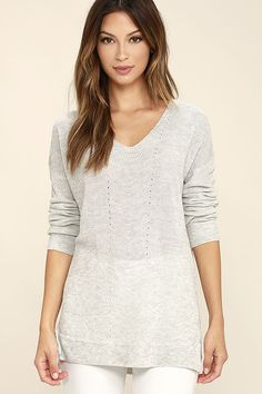 The Casual Friday Heather Grey Sweater is always ready for the weekend! Soft and slightly sheer stretch knit with pierced details sweeps across a V-neck and back, into long sleeves with ribbed cuffs and a banded, notched hem.