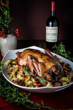 Rum-and-Pomegranate Glazed Christmas Duck with Boozy Chestnut-Apple Stuffing / CaptainsTable Christmas Christmas Duck, Christmas Holidays, English Christmas, Carne, Roasted Duck Recipes, Food Dishes, Main Dishes, Goose Recipes, Tapas