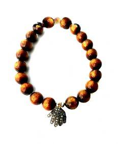 Bracelet Stardust corail or, charm Hamsa argent et diamant Catherine Michiels