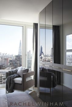The London views are reflected in these contemporary mirrored wardrobes, designed by Rachel Winham Interior Design for a project at Southbank Tower. www.rachelwinham.com