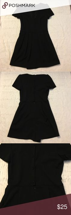 Zara romper Skirt panel in the front looks like a dress, shorts in back. Button up back, back zipper at waist. EUC. Very cute to dress up or be casual! Zara Pants Jumpsuits & Rompers