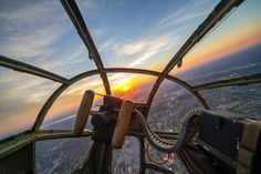"""A sunset is seen through the nose of a B-25 Mitchell during a military tattoo held at Joint Base Anacostia-Bolling in Washington on September 16. The """"warbird flight"""" consisted of two B-25 Mitchells, two P-40 Warhawks, and a P-51 Mustang."""