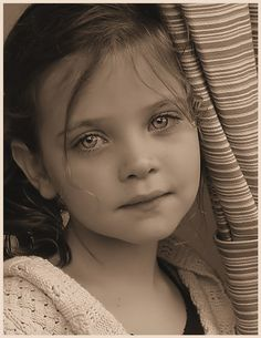 This little girl looks as if she was crying her eyes look as if tears still coat them …..stunning!