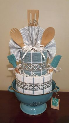 Kitchen towel cake, house warming gift.  I love how well this one turned out.  Check out my Facebook page Simply Showers for more pics and orders. https://m.facebook.com/adorablegifts