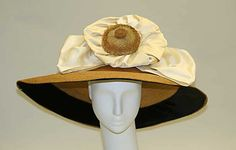 1910. Another superbig straw Hat. I read somewhere that it was in 1911 when this kind of hat reached its maximum diameter, that could be more than 50cm. No wonder now, why you can watch in so many films or read, about girls learning how to walk with a book over their heads.