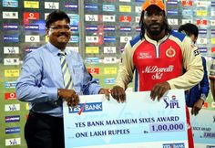 Royal Challengers Bangalore player Chris Gayle recieves Yes bank maximum sixes award during the presentation of the match 70 of the Pepsi Indian Premier League between The Royal Challengers Bangalore and The Chennai Superkings held at the M. Chinnaswamy Stadium, Bengaluru on the 18th May 2013
