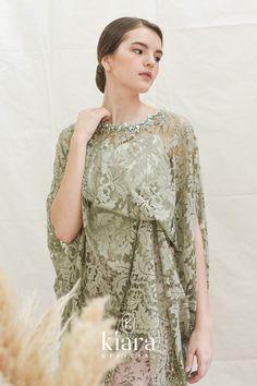 Melati uses a delicate lace draped at the side and is paired with an instant batik skirt. Melati embraces elegance and beauty. Kebaya Lace, Kebaya Hijab, Kebaya Dress, Model Kebaya Brokat Modern, Kebaya Modern Dress, Model Dress Batik, Batik Dress, Hijab Dress Party, Hijab Style Dress
