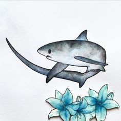 Prep work for a recent necklace design. This is the stage after the line drawing and I've used watercolour paints to add as much detail as I want to the Thresher Shark and the blue lillies.