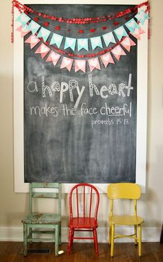 chalkboard :: love this with the colorful chairs and bunting! Playroom idea