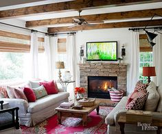 This is almost my living room but with pops of red and wood beams. Would be a good switch for the fall/winter months