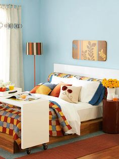 bedroomeasy eye rolling office chairs. warm yellows and oranges complement the cool blues of this cozy bedroom http bedroomeasy eye rolling office chairs e