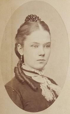 Pretty woman, c.1880s. No information is available about this photograph. Her hairstyle was fashionable at that time.