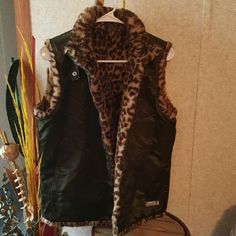 Guess Leopard vest Cute Reversible vest with fur on the inside used but still in good condition Guess Jackets & Coats Vests