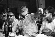 Ernest Hemingway having a hearty drink at a Havana bar (date unknown)