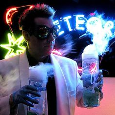 Geoff Notkin, world famous traveler and adventure. The steam-punk goggles, lab coat, neon sign, and not to mention the bubbly concoction. #notyouraveragedayatwork