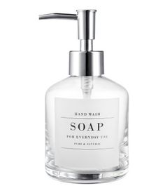 Clear glass. Glass soap dispenser with a printed label at front and plastic pump. Diameter of base approx. 3 1/4 in., height (including pump) 6 1/2 in.