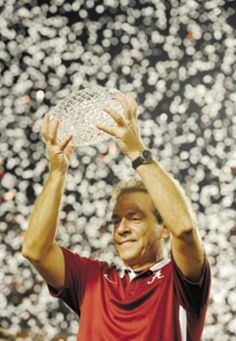 """""""Tidal Domination: Alabama crushes Notre Dame in BCS title game...University of Alabama football coach Nick Saban celebrates with the Coaches Trophy on Monday night after the 2013 Bowl Championship Series title game against the University of Notre Dame at Sun Life Stadium in Miami Gardens, Fla. Alabama won 42-14."""""""