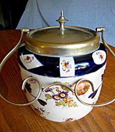 Antique earthenware transferware biscuit jar with fancy handle! For sale at More Than McCoy at www.morethanmccoy.com