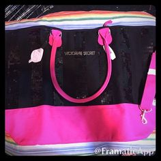 NWT VS travel bag gym bag large New bag. It is black with sequin black stripes. Comes with cross body strap. Large great weekend, travel bag. Still in plastic never used. I can bundle with others. Sorry no trades on this item. Victoria's Secret Bags