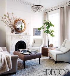 Brooklyn living room:  love the white + brown palette; mirror; ottoman; slipper chairs; especially shag rug