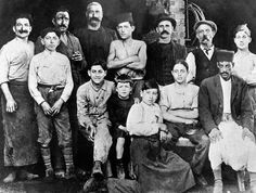 Albert Camus at the age of seven (center, wearing black) in his uncle's workshop, Algiers, 1920. NYRB: Apic/Getty Images.