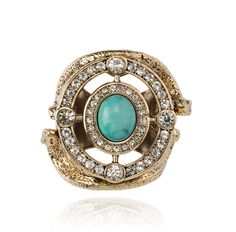 SAMANTHA WILLS - SAHARA SUN RING RRP$130 THE SAHARA SUN RING WILL LEAVE YOU DREAMING OF FAR AWAY LANDS AND EXOTIC DELIGHTS. A CRYSTAL EMBELLISHED FACE SURROUNDS A TURQUOISE STONE, WHILE SNAKE DETAILING AND AN ENSCRIBED MESSAGE WRAPS AROUND THE BASE.
