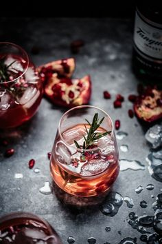 Fresh pomegranate juice mixed with gin, lemon juice, rosemary sugar syrup and topped with soda water. A sweet, tart and earthy Summer cocktail that will soon become your favourite. Dark Food Photography | Moody | Chiaroscuro | Food Photography | Food Styling | Food Props | Anisa Sabet | The Macadames | Pinned to Loveleaf Co.