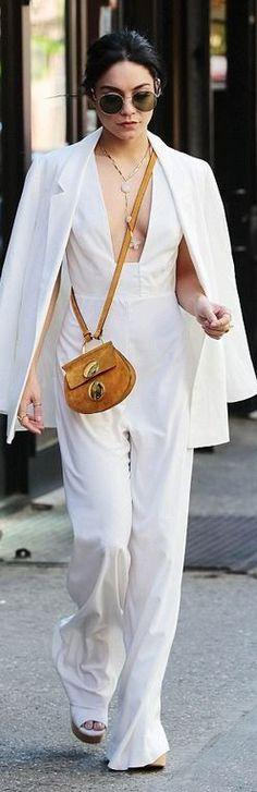 We love Vanessa Hudgens' white jumpsuit with brown suede bag combo.