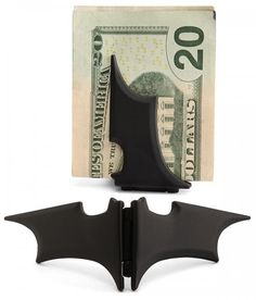 It's a Batman money clip. It's die cast with a magnetic locking mechanism. 4 inches open winged.