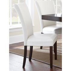 Add modern flare to your dining area with the sleek, Amia side chairs. The classic parsons chair design is given a contemporary boost with its sleek white bonded leather seat and back with rich, espresso finished legs.