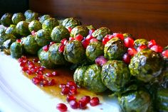 Roasted Brussels sprout stalk with pomegranate seeds