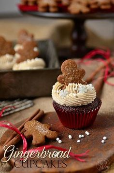So cute! Red velvet cupcakes with mini gingerbread men in the frosting and snowflake sprinkles!