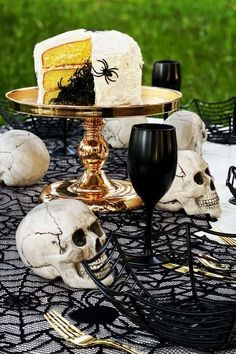 Check out the spooky Halloween skeleton dinner party! The cake covered in spiders is so creepy! See more party ideas and share yours at CatchMyParty.com