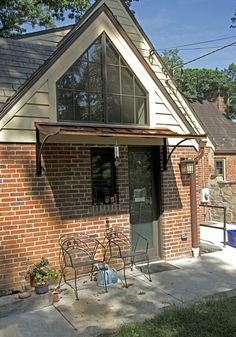 This custom #awning is made of #copper and #iron. While it provides shelter for a back door, it doesn't block valuable light.