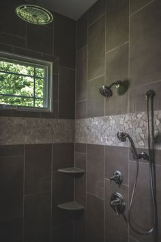 Master bath shower vertical tiles. Robin's Nest Interiors - Louisville Interior Design & Home Accessories Boutique located in the heart of Middletown, KY.