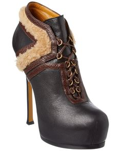 Yves Saint Laurent Tribtoo Leather & Shearling Boot is on Rue. Shop it now.