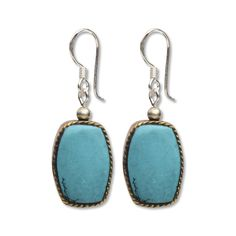 """Romantic turquoise stone beads from Tibet, mounted in twisted silver wire, hung on sterling silver earring wire. Made at the Princess Home in Kathmandu, Nepal. .75"""" exclusive of ear wires. $12.00"""