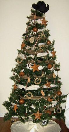 Perhaps I should consider a cowboy tree for my Texas Capitol ornaments! Image detail for -Our natural cowboy Christmas tree in the living room , and mantel . Western Christmas Decorations, Western Christmas Tree, Cowboy Christmas, Primitive Christmas, Christmas Tree Toppers, Country Christmas, Christmas Themes, Christmas Tree Decorations, Christmas Tree Ornaments