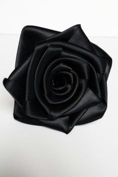 Check out this item in my Etsy shop https://www.etsy.com/ca/listing/251755685/6-black-rolled-ribbon-satin-roses-diy