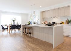 The Adelphi 2 opens up to a spacious kitchen and family area, featuring the walk-in pantry and laundry next to the garage, and four bedrooms all with . Timber Kitchen, Kings Home, Minimal Kitchen, Smart Design, Walk In Pantry, Kitchen Pantry, Living Area, Home Kitchens, New Homes
